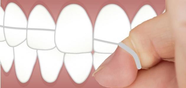 كيف تستخدم خيط الأسنان؟